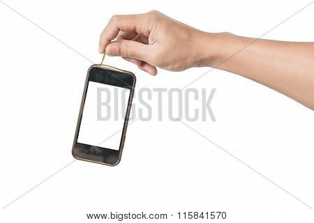 Hand holding old waste smartphone, technology waste, isolated on white background
