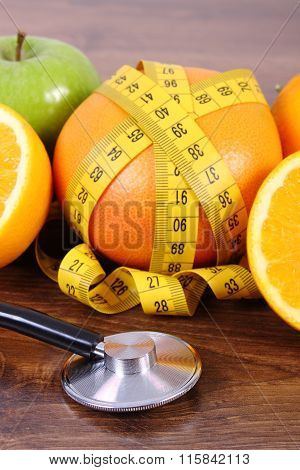 Stethoscope, Fresh Fruits And Centimeter, Healthy Lifestyles And Nutrition