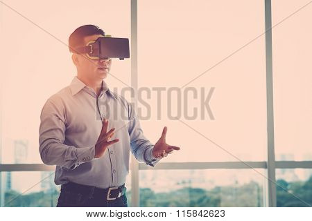 Businessman in VR goggles