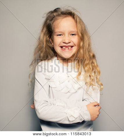 Fun little girl with no teeth. Smiling child