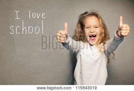 Child about school board. Girl near blackboard