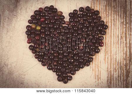 Vintage Photo, Heart Of Fresh Elderberry On Old Wooden Background, Symbol Of Love