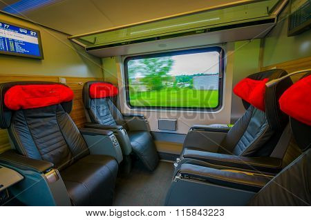 Vienna, Austria - 11 August, 2015: Inside business class seating area on the train,  large black lea