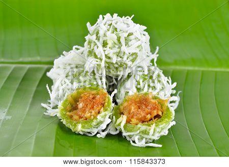 Thai Dessert, Sweet Boiled Ball Dessert With Shredded Coconut On Banana Leaf