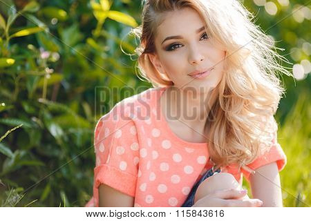 Summer portrait of a beautiful woman.