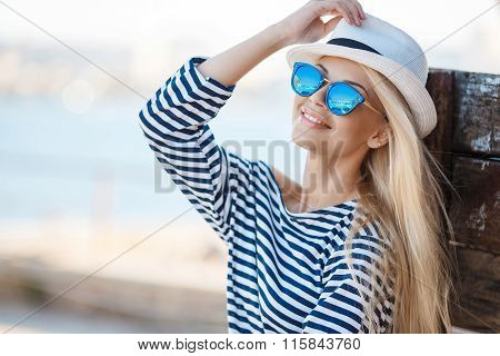 Beautiful woman in striped vest on the dock.