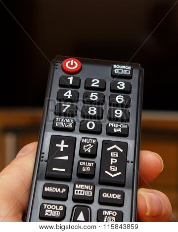 Hand Holding Remote Control For Television