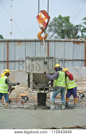 Group of construction workers concreting slab & beam