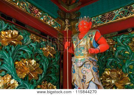 NIKKO, JAPAN - NOVEMBER 17, 2015: Bidara - One of the four guardians at the Yashamon Gate of  Taiyuinbyo - the Mausoleum of Shogun Tokugawa Iemitsu, the grandson of Ieyasa : the first Shogun of the Tokugawa clan