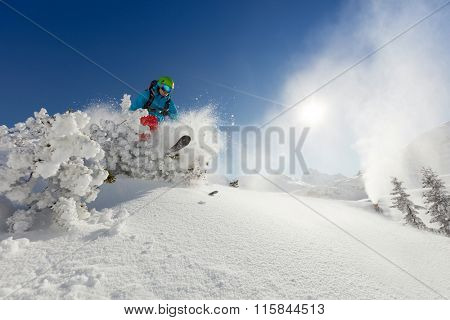 Man freerideer running downhill