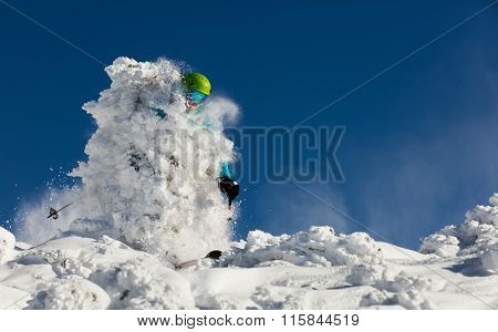 Man freerideer running downhill