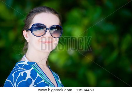 Portrait Of Beautiful Woman In Sun Glasses