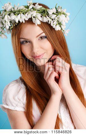 Studio portrait of a girl in wreath of flowers
