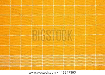 detail of yellow dish towel - background