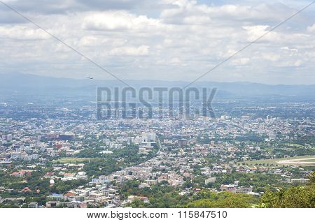View Of Chiang Mai City From A View Point On Doi Suthep Mountain As A Plane Takes Off From Chiang Ma
