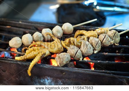 Grilled Squid And Meatball Skewers At A Thailand Night Market