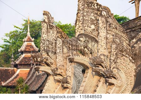 Naga Serpent Sculptures Surrounding The Main Chedi At Wat Chedi Luang In Chiang Mai, Thailand