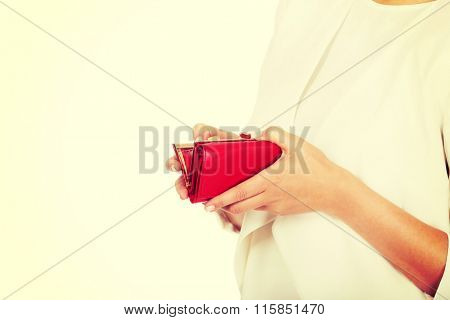 Hands of businesswoman with empty wallet