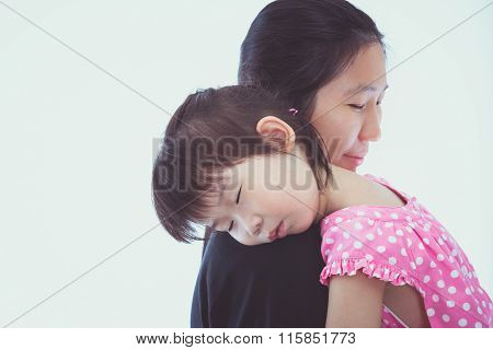 Lovely Asian Girl Sleeping On Mom's Shoulder, On White Background.