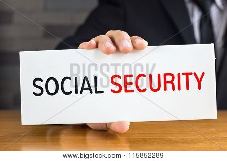 Social Security, Message On White Card And Hold By