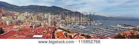 Wide panorama of Monaco, French Riviera. View on Mediterranean sea, yachts and buildings