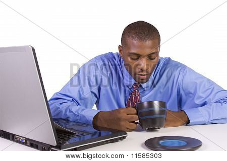 Black Businessman At His Desk Working