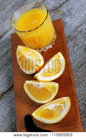 Slices Of Orange And Glass Of Orange Juice