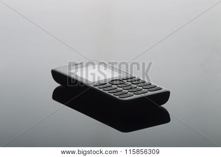 Cell Phone On A Uniform Gradient Background
