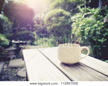 Coffee Cup On Table Outdoor Garden Background Morning Sunrise