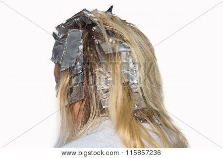 Hair Highlights Wrapped In Aluminum Foil.