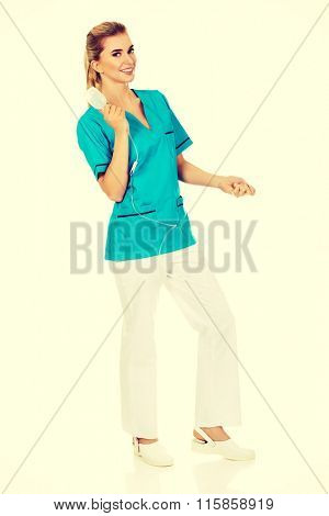 Smiling nurse or doctor holding a drip