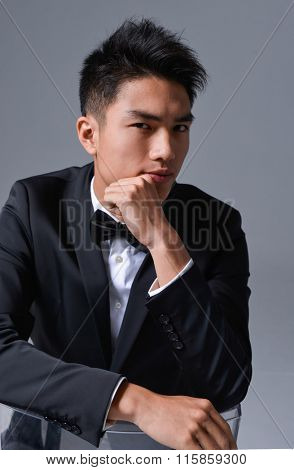 young business man sitting chair