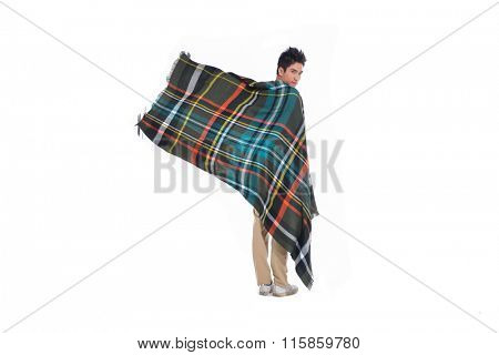 Full body portrait of handsome man warmed up in plaid pattern scarf,
