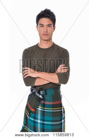 portrait of handsome man warmed up in plaid pattern scarf,