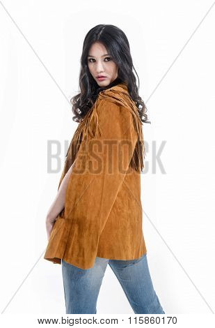 Young lady in jeans. Back Fashion photo