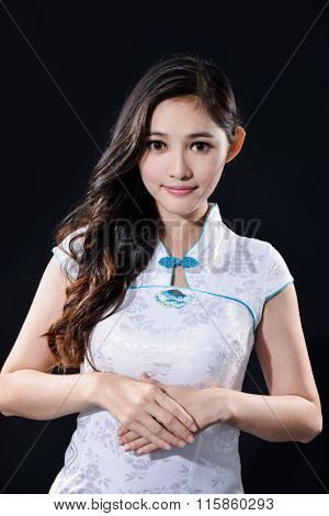 young woman in white cheongsam chinese dress-black background