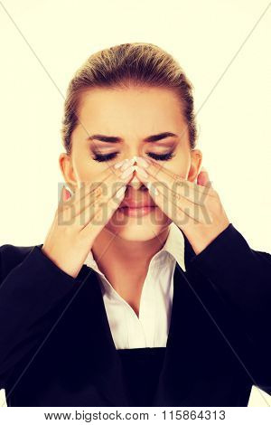 Young businesswoman with sinus ache