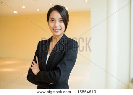Young Businesswoman standing at office