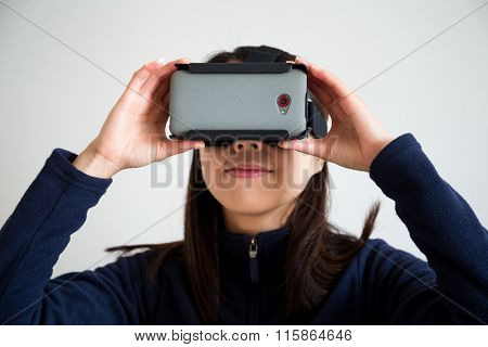 Asian Woman looking though vr
