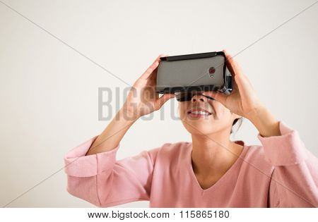 Asian Woman looking though vr device