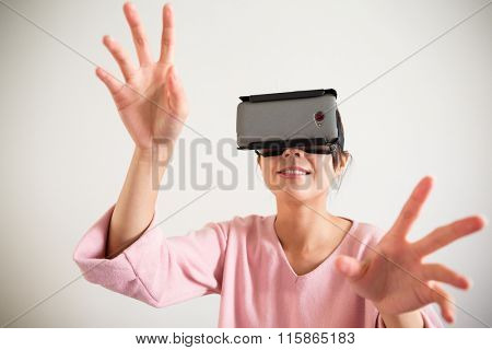 Young Woman wearing with vr device and hand want to touch somrthing