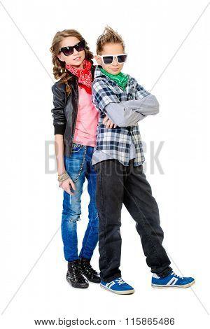Modern teenagers posing together. Studio shot. Full length portrait.
