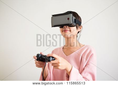 Young Woman play with the virtual reality device