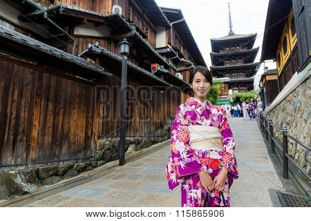 Asian Woman dress up with kimono in yasaka pagoda