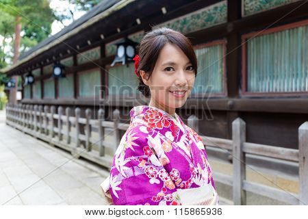 Japanese Woman wearing the kimono dress at temple