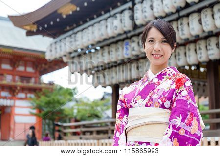 Woman wearing the kimono dress at temple