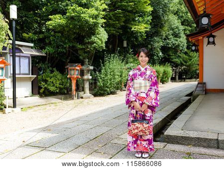 Asian Woman with kimono dress at traditional temple