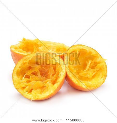 some oranges cut in halves after being squeezed on a white background