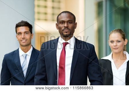 Portrait of an african businessman in front of his team