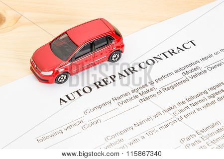 Auto Repair Contract With Red Car On Left View